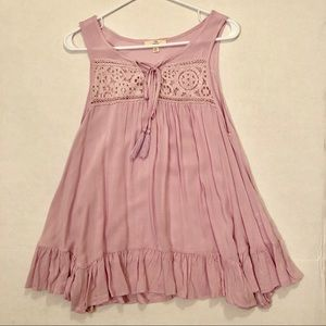 Small sleeveless lavender top with tassels